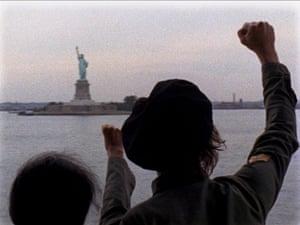 Yoko Ono archive photos: Lennon and Yoko Ono raising their fists to The Statue of Liberty