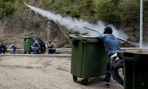 Miners launch a homemade rocket towards riot police in Cinera, Spain