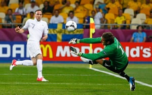 Group D: Sweden's Isaksson saves a shot from France's Ribery