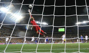 Joe Hart dives for the ball in the first half at the Donbass Arena
