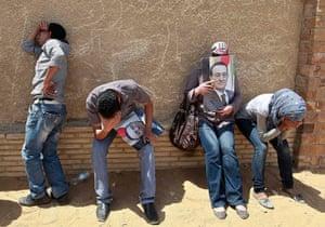 Mubarak Sentencing: Supporters of Hosni Mubarak react after the court verdict