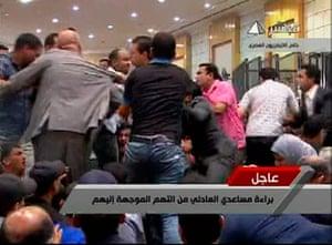 Mubarak Verdict: People scuffle in a courtroom in Cairo after the Mubarak verdict