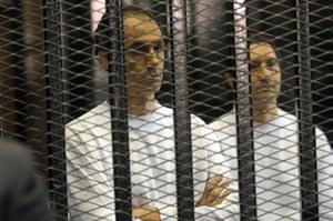 Mubarak Verdict Updated: Gamal Mubarak, (l), and Alaa Mubarak, sons of the former Egyptian president