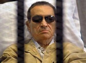 Mubarak Verdict Updated: Mubarak is seen in the defendants' cage as a judge reads the verdict