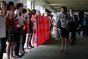 rio+20:  Delegates walk past activists