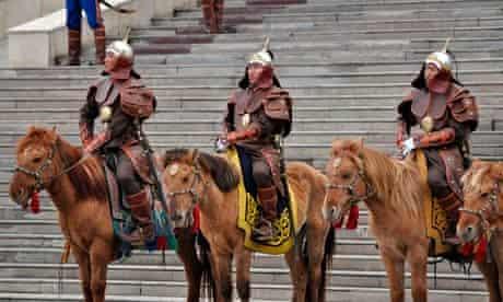 Mongolian soldiers on horseback welcome