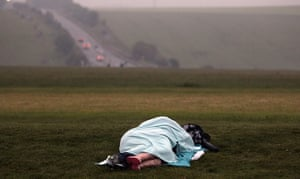 summer solstice: A couple sleep on a slope overlooking the A303