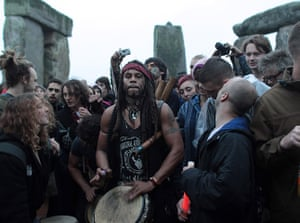 summer solstice: revellers  at stonehenge