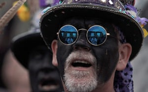 summer solstice: Stonehenge is relected in the glasses of a morris dancer
