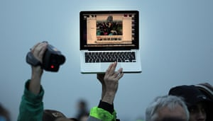 summer solstice: Solstice celebrations are recorded on a laptop and a video camera