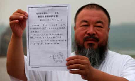 Chinese artist Ai Weiwei holds a copy of