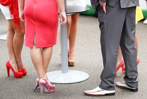 ladies day at ascot : A gentleman sporting highly inappropriate footwear