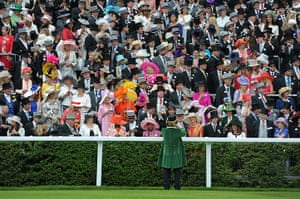 ladies day at ascot : A steward takes a picture for some racegoers