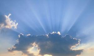 sun shining behind cloud