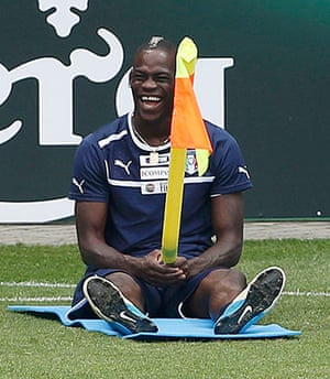 Balotelli: Italy's soccer player Balotelli plays with a corner flag