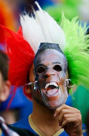 Balotelli: Italian supporter wearing Mario Balotelli's face mask