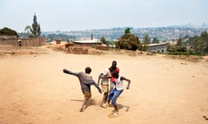 Boys play football in Rwanda