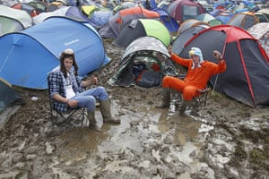 Isle of White: Blaise Franklin and Nathan Mursall wallow in the mud by their tents