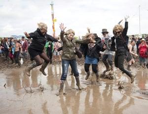 ISle of Woght: Festival-goers splash in the mud