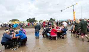 ISle of Woght: A general view of the festival site covered in mud