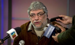 Ousted Paraguayan president Fernando Lugo speaks into a microphone