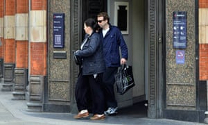 A couple leave a branch of a NatWest bank in London