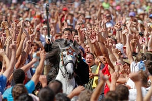 24 hours: Ciutadella de Menorca, Spain: A young rider spears a suspended ring