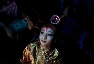 24 hours: Patan, Nepal: Kumari Samita Bajracharya, 10, has her make-up done