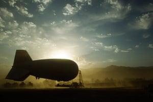24 hours: Kunar Province, Afghanistan: A sandstorm blows past an inflatable blimp