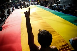 Gay pride week: Lisbon, Portugal: Revelers hold a giant flag during the parade