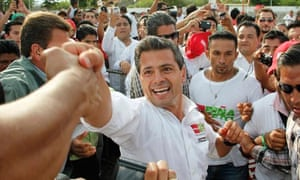 The PRI candidate Enrique Peña Nieto greets supporters