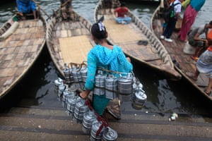 24 hours in pictures: A woman boards a boat carrying food baskets
