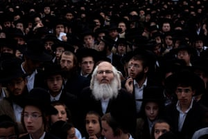 24 hours in pictures: Ultra Orthodox Jewish men participate in a prayer