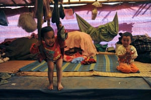 24 hours in pictures: Refugee children from Burma Bhamo city play inside a tent at a rescue camp