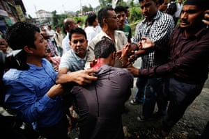 24 hours in pictures: A Nepalese anti-government protester shows his wound