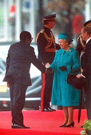 Queen shaking hands: Robert Mugabe Meeting The Queen