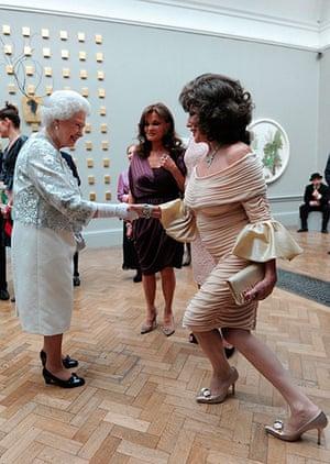 Queen shaking hands: Queen meets Joan Collins