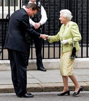 Queen shaking hands: Queen meets David Cameron