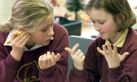 Two schoolgirls count on their fingers