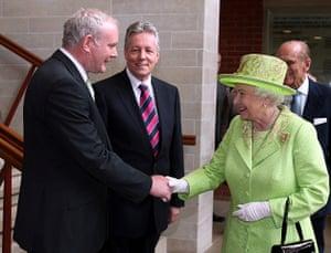 Queen : Queen Elizabeth shakes hands with Martin McGuinness