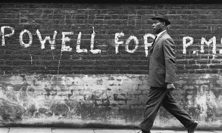 Man Walks Past Powell Graffiti