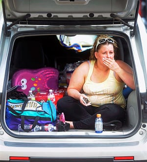 Wildfires in Colorado: Christina Morris watches the fire as she prepares her family for evacuation
