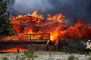 Wildfires in Colorado: A firefighter tackles the flames at Estes Park, Colorado