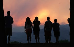 Wildfires in Colorado: People watch smoke rising from the Waldo Canyon Fire at sunset