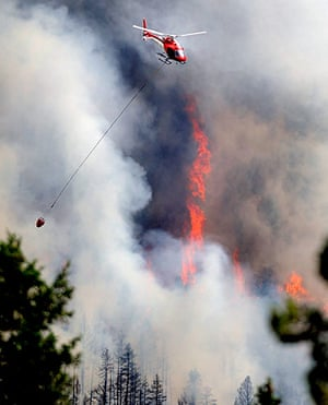 Wildfires in Colorado: A firefighting helicopter flies above the Flagstaff fire  west of Boulder