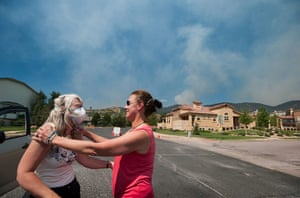 Wildfires in Colorado: People deal with the effect of smoke rising over Cascade