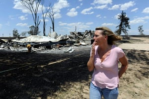 Wildfires in Colorado: A woman surveys a house that has burned down in Woodrow