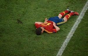 sport7: Spanish midfielder Xabi Alonso lies on t
