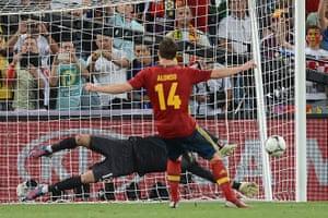 sport12: Spanish midfielder Xabi Alonso kicks a p