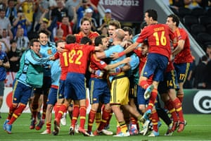 sport13: Spanish players celebrate at the end of
